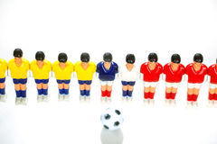 Foosball table players Royalty Free Stock Image