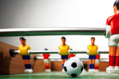 Foosball table players Royalty Free Stock Photo
