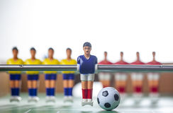 Foosball table players Royalty Free Stock Photography