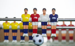 Foosball table players Stock Photos