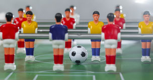 Foosball table players Stock Images