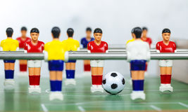 Foosball table players Royalty Free Stock Images