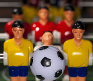 Foosball table players Stock Photo