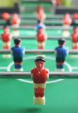 Foosball (table soccer) field with players. Green table with red and blue players. Selective focus Royalty Free Stock Photo