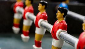 Foosball or Table Soccer Men Stock Images