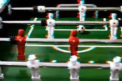 Foosball table soccer sport team football players.  stock photos
