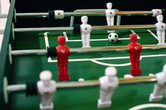 Foosball table soccer sport team football players.  royalty free stock image