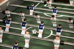 Foosball table or table soccer and players Stock Image
