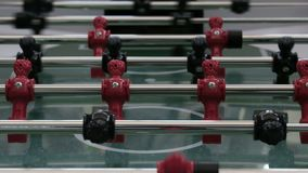 Foosball team competition and sports entertainment. The table game soccer players. The figures for the game of table. The table game soccer players. Foosball stock video