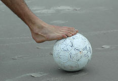 Foot above the ball Royalty Free Stock Images