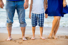Foot adults and a child on the beach Royalty Free Stock Images