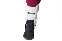 Foot with ankle brace Stock Images