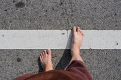 Foot of Asian boy on the road Royalty Free Stock Photography