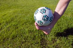 Foot and ball. Stock Image
