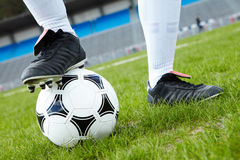 Foot on ball Stock Photography