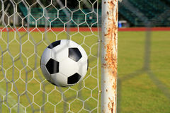 Foot ball in the goal net Royalty Free Stock Images