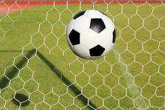 Foot ball in the goal net Royalty Free Stock Photos