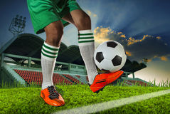 Foot ball player holding foot ball on leg ankle on soccer sport Royalty Free Stock Image
