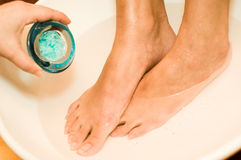 Foot Bath. Bath salts are applied to a foot bath Royalty Free Stock Photography