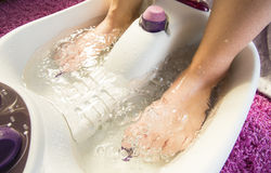 Foot bath massage Royalty Free Stock Images