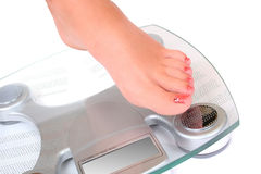 Foot on a bathroom scale Stock Photo