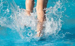 Foot boy in the pool. In the park in nature Royalty Free Stock Photo