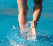 Foot boy in the pool. In the park in nature Stock Photography