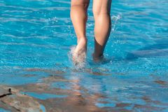 Foot boy in the pool. In the park in nature Royalty Free Stock Image