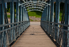 Foot bridge. A wood and metal foot bridge Royalty Free Stock Photos