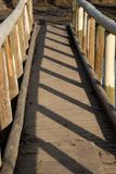 Foot bridge. Wooden rail foot bridge over small creek Stock Photos