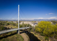 Foot bridge in Arvada Colorado. A foot bridge passing through a forest and over a river in Arvada, Colorado Royalty Free Stock Photos