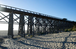 Foot bridge at a beach with nobody. Present Stock Photo