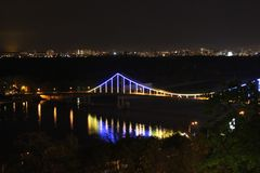 Foot bridge illuminated as a central part of night Kiev royalty free stock photos