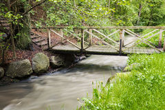 Foot bridge over creek Stock Images