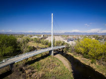 Foot bridge over a river in Arvada Colorado. A foot bridge crossing over a river in Arvada, Colorado Royalty Free Stock Photo