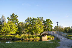 Foot bridge through river in city park Royalty Free Stock Photography