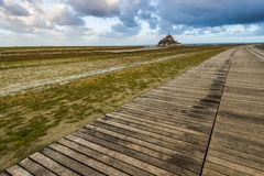 Foot bridge to Mont Saint Michel in France. Foot bridge to famous Abbey in Mont Saint Michel in France Stock Photos