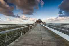 Foot bridge to Mont Saint Michel in France. Foot bridge to famous Abbey in Mont Saint Michel in France Stock Photo