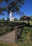 Foot Bridge and White Church Royalty Free Stock Image