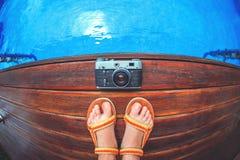 Foot and camera royalty free stock photo