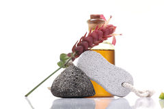 Foot care items. Pumice stones and oil isolated on white background Royalty Free Stock Photography