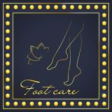 Foot care logo. Pedicure logo in gold. Golden silhouette of female legs and lotus flower on a dark blue background. Stock Photography