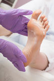 Foot care massage with cream. Pedicure SPA procedure. Royalty Free Stock Photography