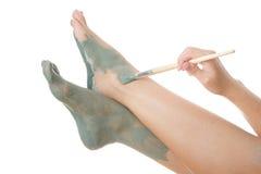 Foot Care. Mud treatment. Foot Care. Mud treatment mask for leg Stock Photography