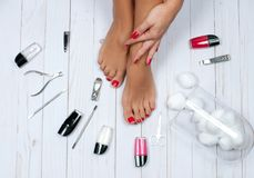 Beautiful female feet at spa salon on pedicure procedure. Foot care treatment and nail. Beautiful female feet at spa salon on pedicure procedure Royalty Free Stock Photography