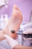 Foot care treatment ,woman at the beautician for pedicure Stock Image