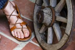 Foot and a cart wheel royalty free stock photo