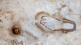 Foot carved on marble. TURKEY - AUGUST 13, 2017: A foot carved on marble in front of the brothel in ancient Ephesus Stock Photo