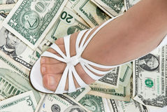 Foot on cash Royalty Free Stock Photography