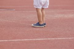 Children`s foot wear sport shoes standing stock photo